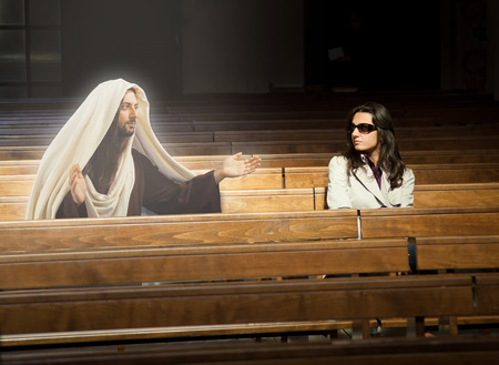 supplicate: Woman praying in church and sees Jesus Christ.