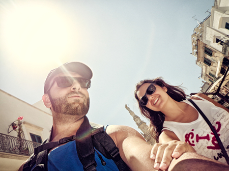 backlite: Young couple while taking a Selfie in Ostuni, Italy