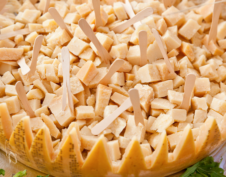 parmesan cheese: Pieces of parmesan cheese at refreshments marriage.