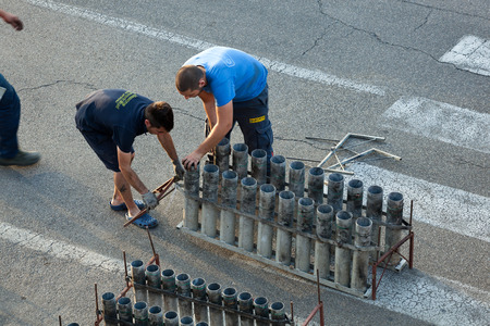 pyrotechnic: Florence, Italy - June 23, 2016: Workers work for the preparation of the fireworks for the pyrotechnic event to be held on the day of St. Giovanni Battista on June 24. Editorial