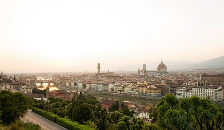 fiore: Golden sunset of Palazzo Vecchio and Cathedral of Santa Maria del Fiore, Florence, Italy.