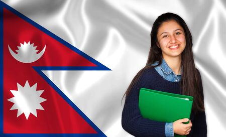 lessons: Teen student smiling over Nepalese flag. Concept of lessons and learning of foreign languages. Stock Photo