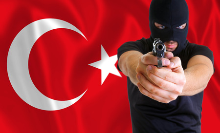coup: Concept of coup in Turkey. Masked armed man. Stock Photo