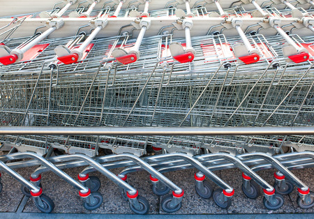 Rows of shopping carts at the entrance of supermarket Stock Photo
