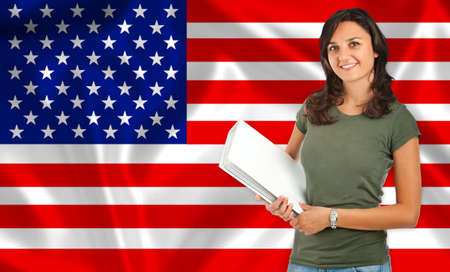 Student smiling over United States flag. Concept of lessons and learning of foreign languages. Stock Photo