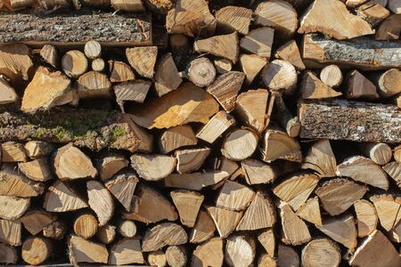 stack of firewood: Close up of firewood stack background.