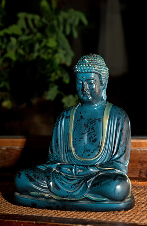Buddha marble statue, he is recognized by Buddhists as an enlightened or divine. Stock Photo