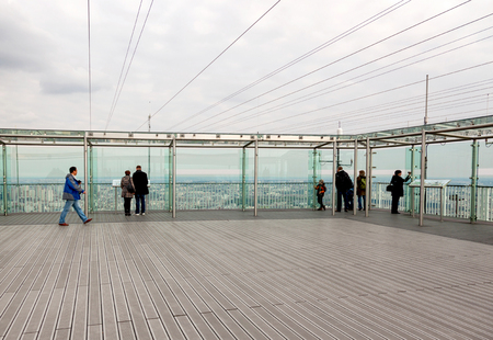 metre: Paris, France -  April 28, 2013:  Tourists at the roof of the Montparnasse Tower in Paris. Commonly named Tour Montparnasse, is a 210 metre, Constructed from 1969 to 1973.