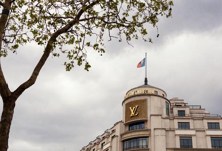 Paris, France -  April 28, 2013:  Louis Vuitton shop at Champ Elysee avenue. Louis Vuitton is one of the worlds leading international fashion houses.