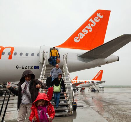 Paris, France -  April 28, 2013: Passengers descend from the airplane of EasyJet to enter the bus. Easyjet is the second largest low-cost airline of Europe after Ryanair. Editorial