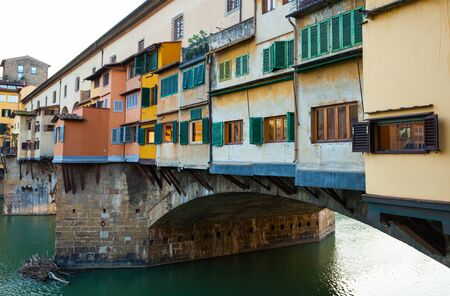 ponte vecchio:  Beautiful view of famous Ponte Vecchio with river Arno at sunset