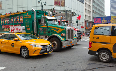 New York City, Usa - July 12, 2015: Cars, trucks and yellow cabs in downtown Manhattan. The traffic is always congested during peak hours.