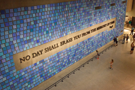 virgil: New York City, Usa - July 12, 2015: A wall in the National September 11 Memorial Museum is inscribed with a quote from Virgil created with steel taken from the Twin Towers. Editorial