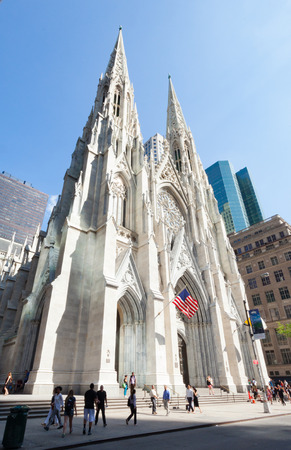fifth avenue: New York City, Usa - July 10, 2015: Exterior of the front of St. Patricks Cathedral on Fifth Avenue. It is an example of the decorated and geometric style of Gothic ecclesiastical architecture.