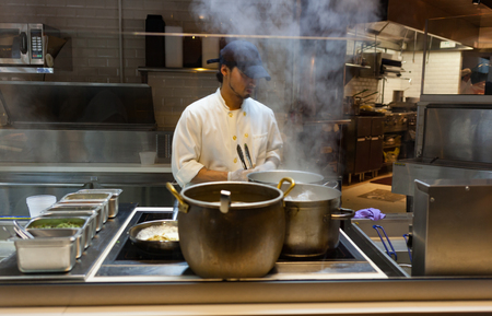 chelsea market: New York City, Usa - July 11, 2015: Chef cooking pasta in the restaurant Giovanni Rana in Chelsea Market, Manhattan.