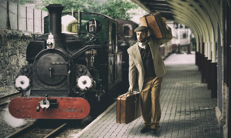 Emigrant to the train station with cardboard suitcases. photo
