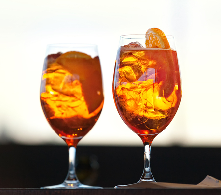 Two glasses of spritz cocktail at sunset.