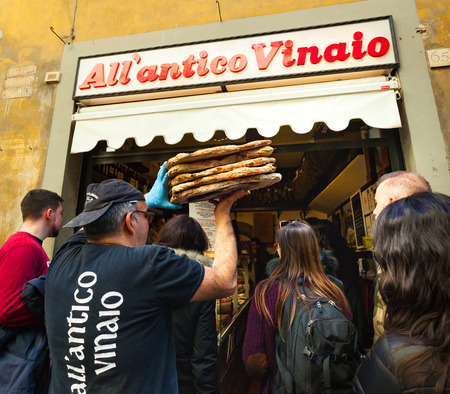 sign: Florence, Italy - February 14, 2017: AllAntico Vinaio is among the best national street-food in Italy. The venue is a historic winery in Florence pecialized in typical Schiacciata with salumi. Editorial