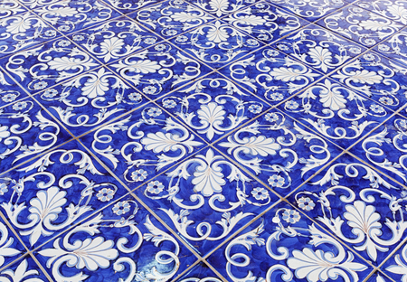 Tile texture background with blue majolica. Stock Photo