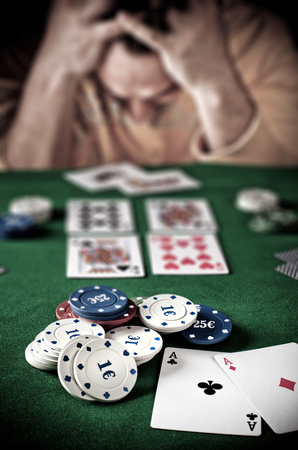 Lose player at the poker green table. photo