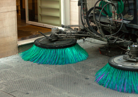 A street sweeper machine cleaning the streets.