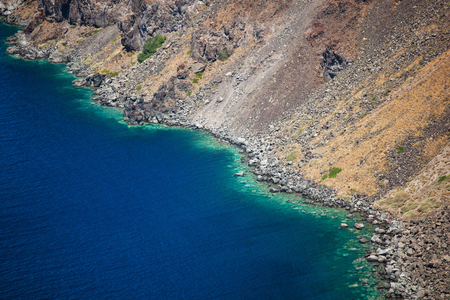 Volcanic mountains and turquoise water in Santorini island, Greece.