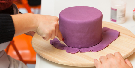 Pastry lesson, working on the figures of Halloween with fondant paste or sugar paste. Stock Photo