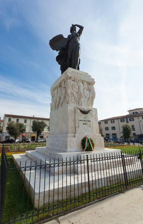 Empoli Italy - 04 november 2017: The bronze statue in Della Vittoria Square of the goddess Victory in realized by Dario Manetti and Carlo Rivalta in 1925. Day of inauguration of new gardens. Editorial