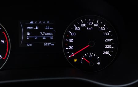 Fuel consumption theme. Empty tank indicator on car dashboard.