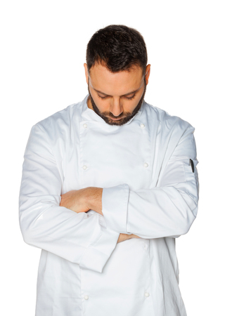Young chef  sleeping in white uniform isolated on white background.