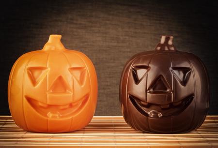 Two Pumpkin chocolate halloween on dark background