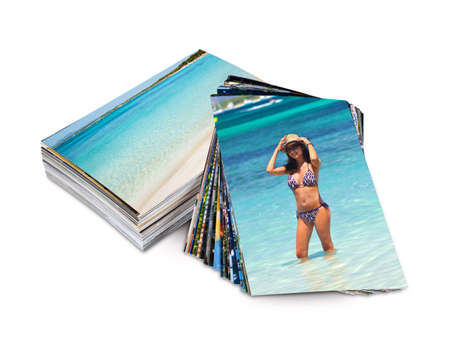 Many photos printed on photo paper with example of a tourist on vacation. Stok Fotoğraf