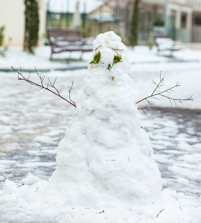 Ugly Snowman standing in front of snow background.