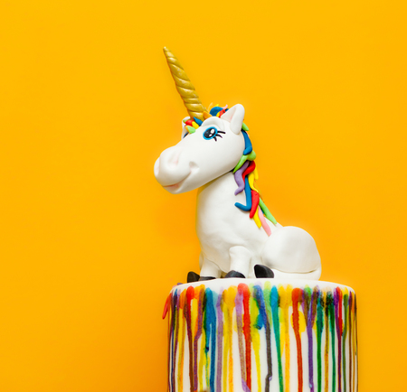 Unicorn cake topper made with in sugar paste or Fondant. Stock Photo