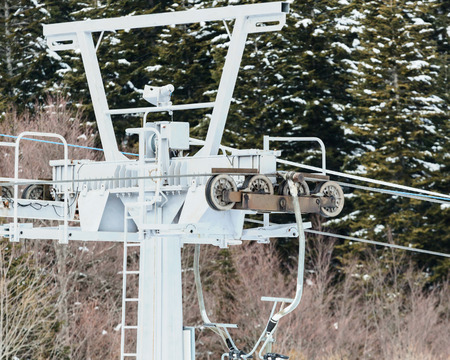 Chairlift in the ski resort. Roller system of ski lift in the ski resort.