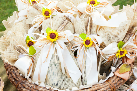 Basket of Rustic wedding favors with sunflowers. Stock Photo
