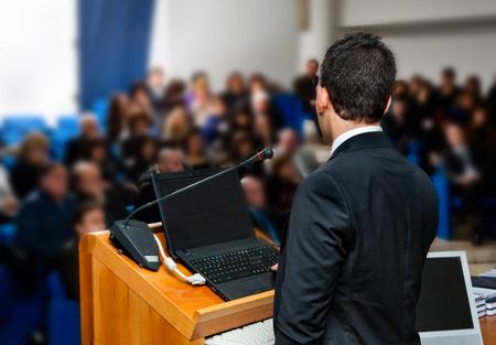 Business people group at meeting seminar presentation.
