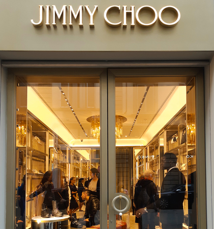 Florence, Italy - November 04, 2018: The famous brand Jimmy Choo has opened a store in Florence. it is an iconic luxury fashion brand that stands out for its strong sense of glamor. 報道画像