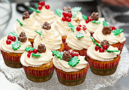 Gingerbread cupcake or muffin with Christmas decoration. Foto de archivo