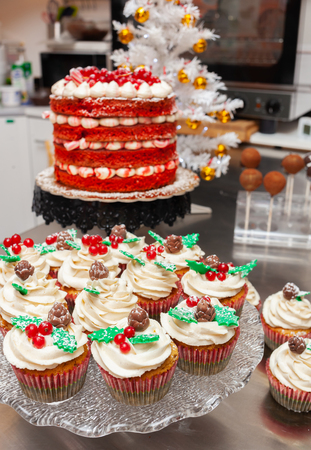 Photograph of christmas sweets, red velvet cake and gingerbread cupcake. Archivio Fotografico - 113641323