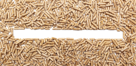 Frame made with alternative biofuel from sawdust wood pellets. Foto de archivo - 116534008