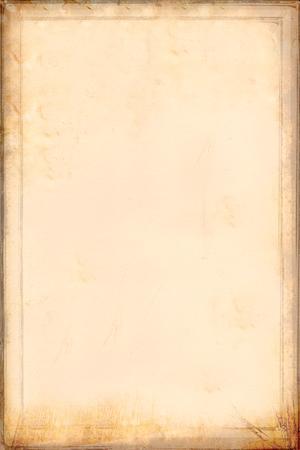 Antique yellowish parchment paper grungy background texture Banco de Imagens
