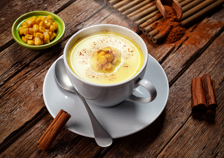 Corn Atole, beverage with maize, milk and cinnamon. Фото со стока