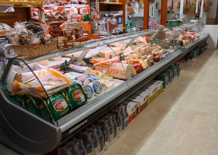 """Mondragone, Italy - Jennuary 01,2010: Counter of the """"Antichi Sapori"""" Minimarket with cheeses, meats and meats."""