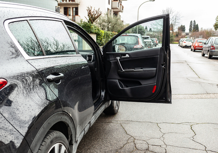 Car Door of Forgotten Open. Danger concept for car accidents. 스톡 콘텐츠