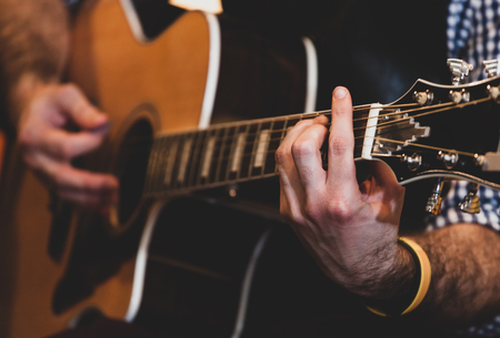 Close up of hands playing classic guitar. Selective focus. 版權商用圖片