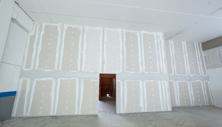 Wall made from plasterboard drywall and prepared to painting in industrial construction.