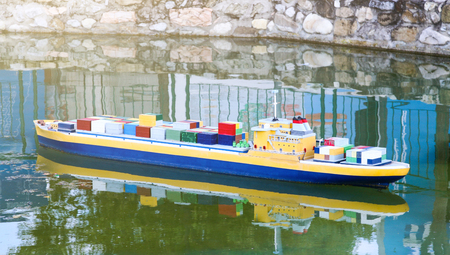 Miniature of ship cargo containers in a sunny day.