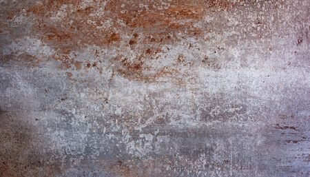 Large porcelain stoneware tiles for coverings. Stone and rust color background.