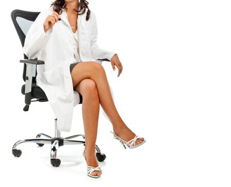 Female doctor sitting with crossed legs isolated on white background. Copy space.